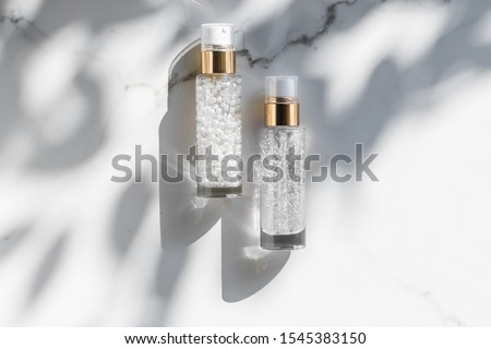 Stock photo: Holiday make-up base gel, serum emulsion, lotion bottle and rose