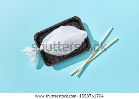 Plastikowe worek ryb tablicy pałeczki do jedzenia Zdjęcia stock © artjazz