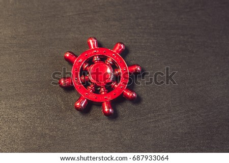 Famous fidget spinner stress relieving n a black wooden background. And the inscription spinner Stock photo © galitskaya