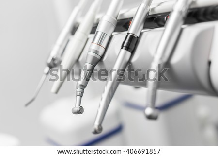 modern metallic dentist tools and burnishers on a dentist chair stock photo © illia