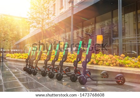 Electric scooters for rent. urban transport. Electric Ride Sharing Scooters Lined Up and Ready to Re Stock photo © galitskaya