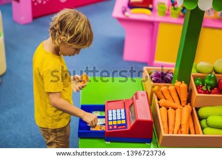 Fiú pénztárgép pénzügyi műveltség gyerekek szalag Stock fotó © galitskaya