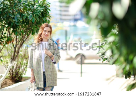 A woman 30-35 years old walks in the early autumn in the European Park while on vacation Stock photo © ElenaBatkova