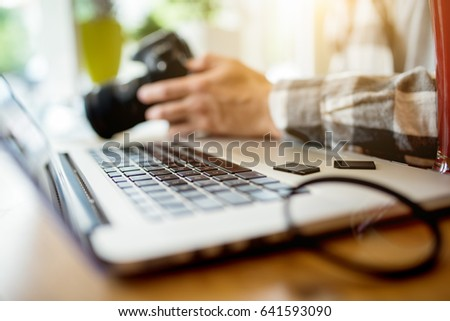 Hands of young freelance designer retouching photos on screen of graphics tablet Stock photo © pressmaster