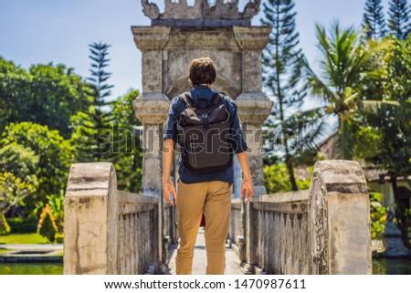 Young man in Water Palace Soekasada Taman Ujung Ruins on Bali Island in Indonesia. Amazing old archi Stock photo © galitskaya