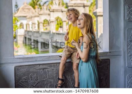 Mom and son in Water Palace Soekasada Taman Ujung Ruins on Bali Island in Indonesia. Amazing old arc Stock photo © galitskaya