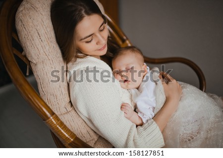 Affectionate mother embraces her little daughter as sit together Stock photo © vkstudio