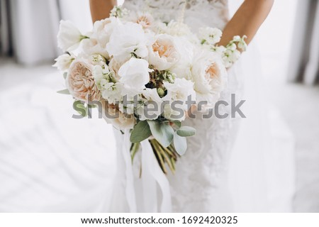Beautiful young bride in white wedding dress, holds bouquet, has talk with her future husband, have  Stock photo © vkstudio