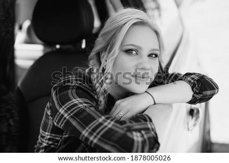 Blond girl sitting near red car Stock photo © jossdiim