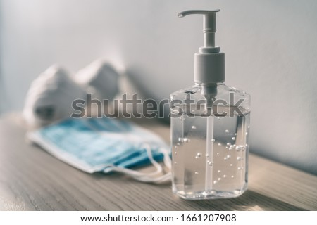 Corona virus hand sanitizer alcohol gel rub coronavirus prevention washing hands bottle dispenser at Stock photo © Maridav