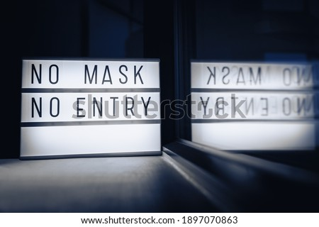 NO MASK NO ENTRY. Covid-19 mask wearing mandatory in many countries when going outside of home. Coro Stock photo © Maridav