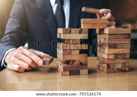 Hands of executive cooperation placing wood block on the tower,  Stock photo © Freedomz