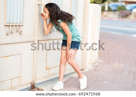 Portrait of a little girl peeping through window with jalousie Stock photo © zurijeta
