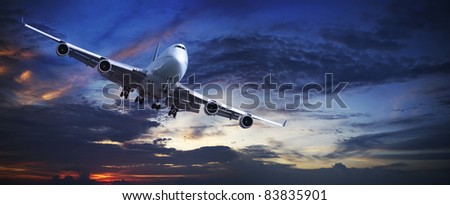 Jet plane is maneuvering in a sky at sunset time. Panoramic shot Stock photo © moses