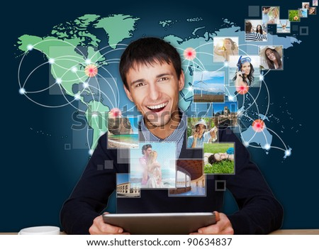 A technology man has images flying away from his modern tablet c Stock photo © HASLOO