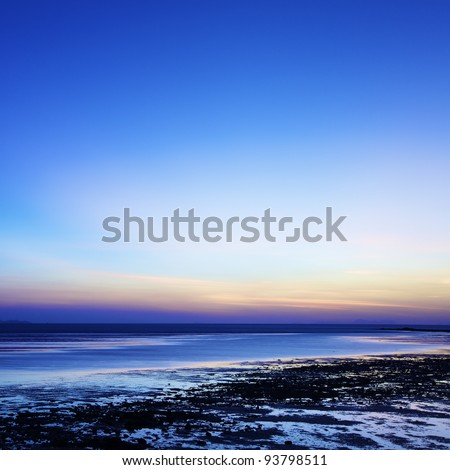 sunrise over the beach at low tide square composition long exp stock photo © moses