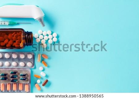 spilled tablets and medicine bottletablets on a green backgroun stock photo © tatik22
