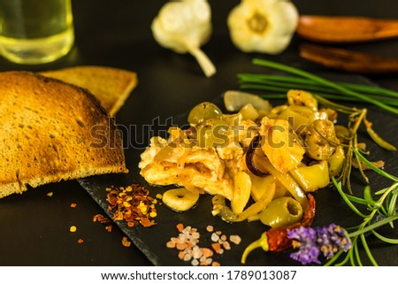 homemade spicy marinated cheese with oil, onion, garlic and spicy spices Stock photo © artush