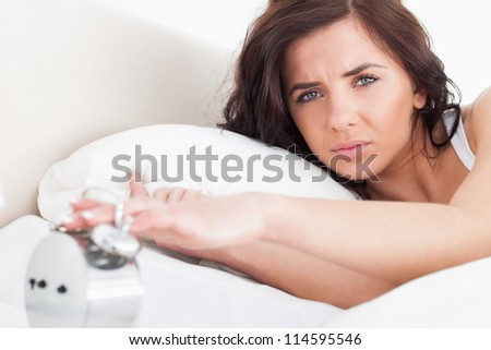 alarmclock waking up a woman with the camera focus on the object stock photo © wavebreak_media