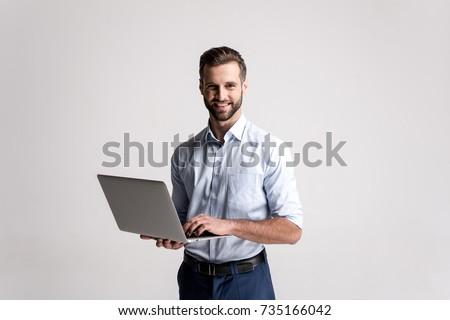 sorridente · moço · trabalhando · laptop · branco · computador - foto stock © wavebreak_media