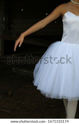 Stockfoto: Woman Posing In Black Dress With Ruffled Skirt On White Background