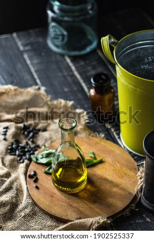 Bottle of traditionaly made extra virgin olive oil with herbs Stock photo © monticelllo