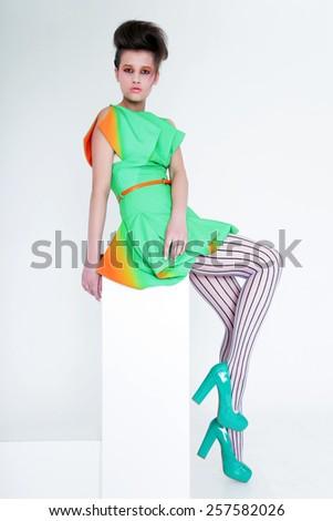 Divat pompás nő ül modern ruházat Stock fotó © gromovataya