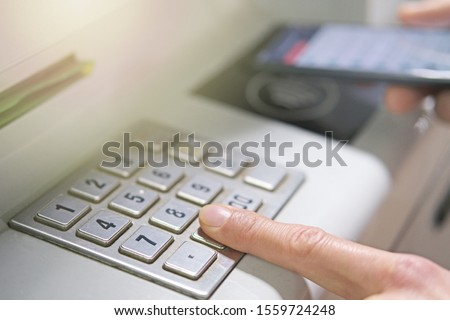 withdrawing money atm with mobile phone (NFC near field communic Stock photo © REDPIXEL