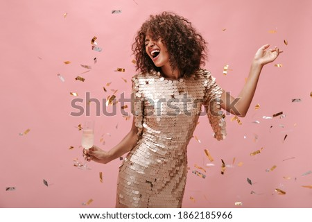 Gorgeous woman with a glass of champagne on the background of a  Stock photo © gromovataya