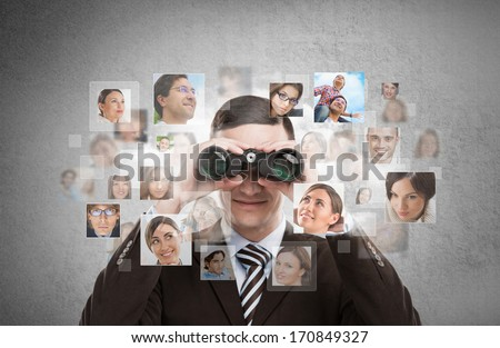 Business man looking for employees through binoculars. Lots of p stock photo © hasloo