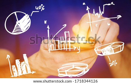 Stockfoto: Man Using Mobile Phone With Drawings Of Charts And Other Infogra