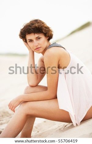 Fashionably Dressed Attractive Young Woman Sitting Amongst Sand  Stock photo © monkey_business