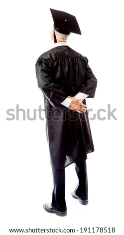 rear view of a senior male graduate standing with hands behind b stock photo © bmonteny