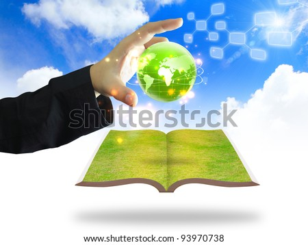Hand holding house on green grass with tree, solar panels, wind turbine of screen laptop. Background Stock photo © cherezoff