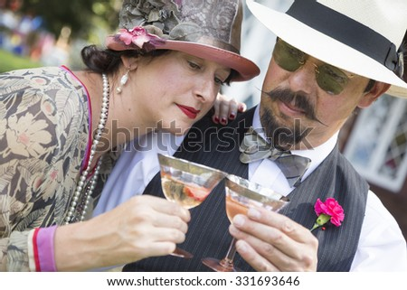 Mixed-Race Couple Dressed in 1920's Era Fashion Sipping Champa Stock photo © feverpitch
