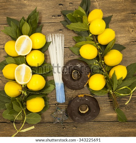 Branch lemons  donuts candles  crown of thorns and goat horn. Symbols of the great holiday of Hanuk Stock photo © mcherevan