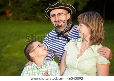 Stock photo: Man in pirate suit with wife and son in early fall evening park