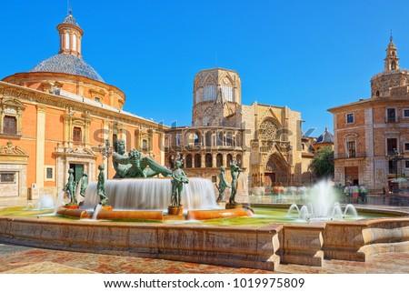 Square of Saint Mary's, fountain Rio Turia and Valencia Cathedral in a cloudy day. Valencia, Spain. Stock photo © artjazz
