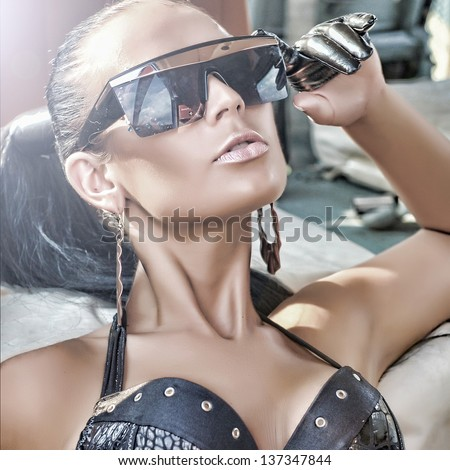 fashionable lady wearing sunglasses with helicopter in the background Stock photo © konradbak
