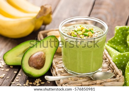 Stock photo: Avocado and banana smoothie with oats with ingredients in glass jar on wooden background, healthy ea