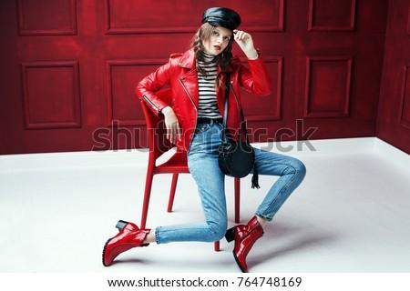 Jovem jaqueta de couro jeans boné Foto stock © chesterf