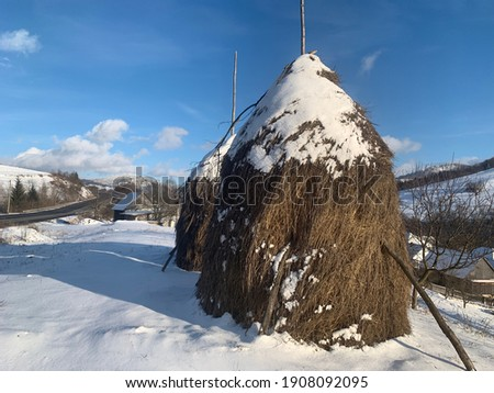 Stock photo: Rural landscape in the mountains. Haystacks dry hay in the field