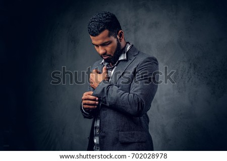 stylish, trendy businessman in a business suit on a black backgr stock photo © Traimak