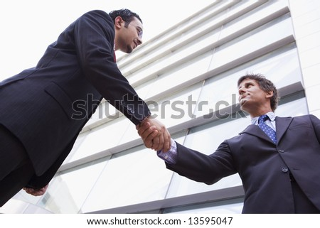 two middle eastern businessmen shaking hands outside an office b stock photo © monkey_business