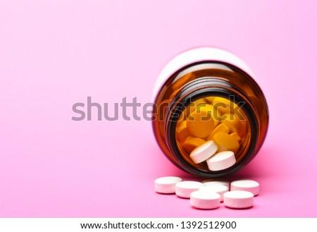 Open prescription bottle of opioid pain killer tablets on USA ru Stock photo © tab62