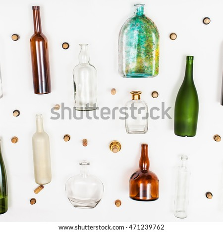 top view of several glass bottles with cork empty with shadows and reflection on a blue background stock photo © artjazz