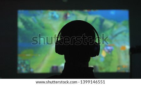 Hands of professional gamer man playing video games on computer  Stock photo © deandrobot