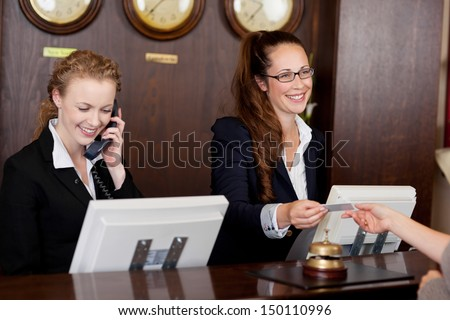 Female receptionist in a hotel with a reception bell hand drawn outline doodle icon. Stock photo © RAStudio