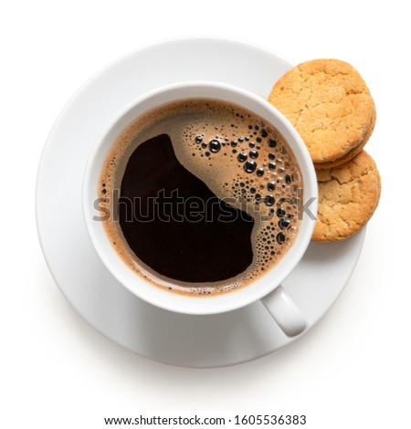 Black coffee cup with saucer and black sandwich cookies on black stone kitchen table background.  Br Stock photo © DenisMArt