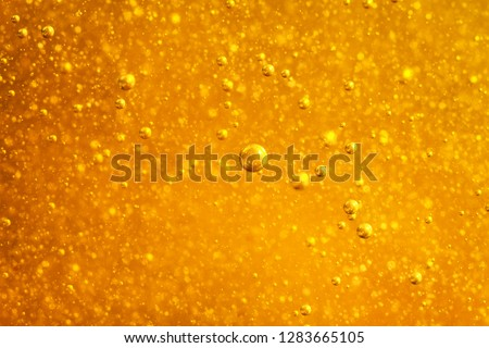 Close-up of natural sweet flower honey dripping from stick on a gray stone table. Rosh hashanah jewi Stock photo © artjazz